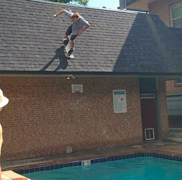 Two Girls Jump Off Of Roof Into Pool But One Misses