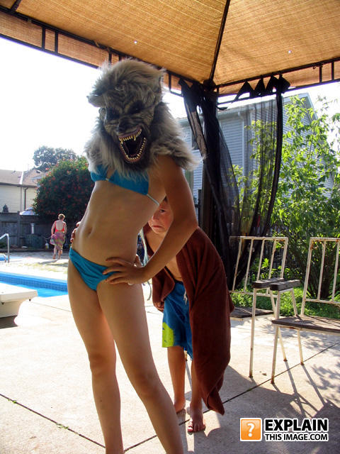 bikini girl wearing scary wolf mask