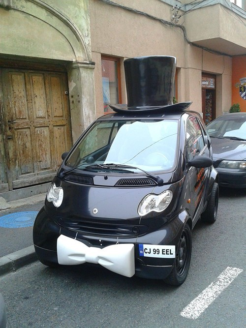 car, top hat, moustache, like a sir