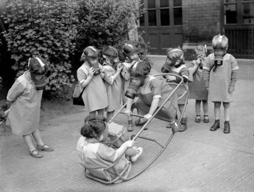 wtf, kids, teeter todder, gas masks