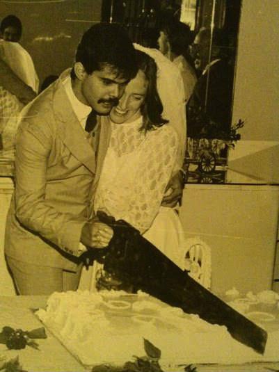 groom cutting wedding cake with a big saw, wtf
