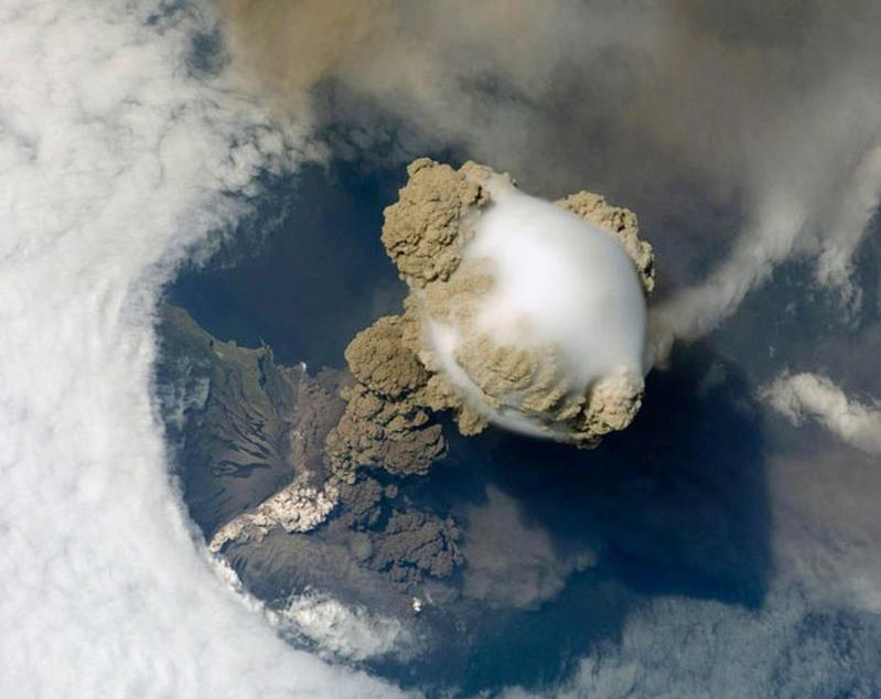 View of Sarychev Volcano in the Kuril Islands Russia going through its early stage of eruption, taken from the orbit of the International Space Station in June 2009