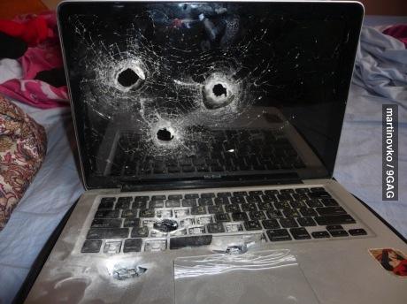 macbook, bullet holes, wtf