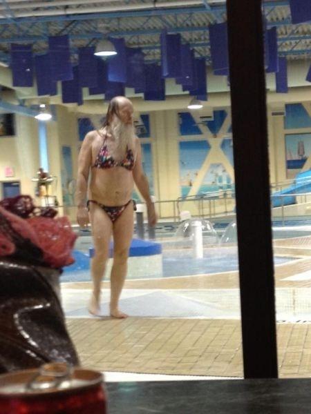 bearded man in bikini at pool parc