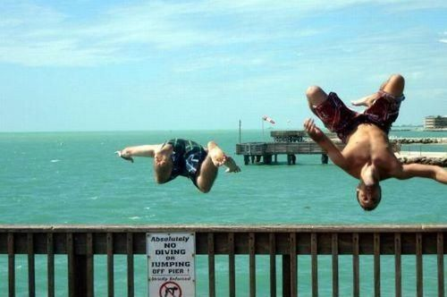 sign, rebels, jump, pier, water, flip, dive