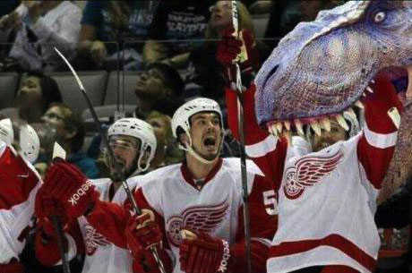 hockey player being eaten by dinosaur with teammate reacting, lol, photoshop or not?