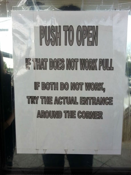 push to open, if that does not work, pull, if both do not work, try the actual entrance around the corner, troll sign