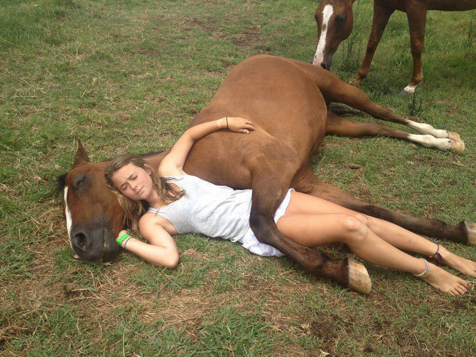 girl and her horse spooning