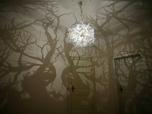 this lamp makes your room look like a dark forest, win