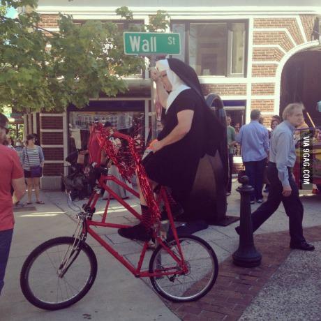 Fucks given level - nun, man wearing a habit riding a tall bike