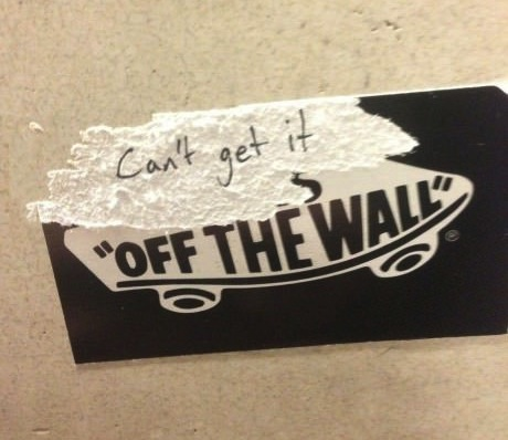 can't get it off the wall, half ripped vans sticker, lol