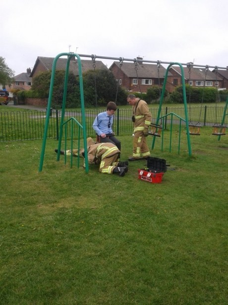 guy gets stuck in swing and has to call the fire department, shame, fail