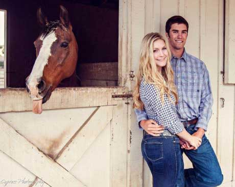 horse photobombs couple by sticking out tongue