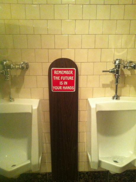 remember the future is in your hands, urinal, sign