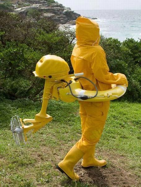 poorly dressed, wtf, rain gear, motor, yellow