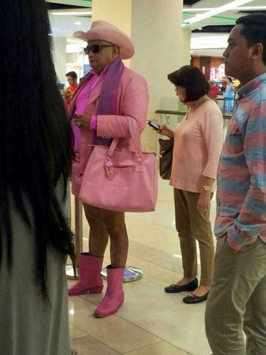 man wearing all pink ladies' clothes, poorly dressed, wtf