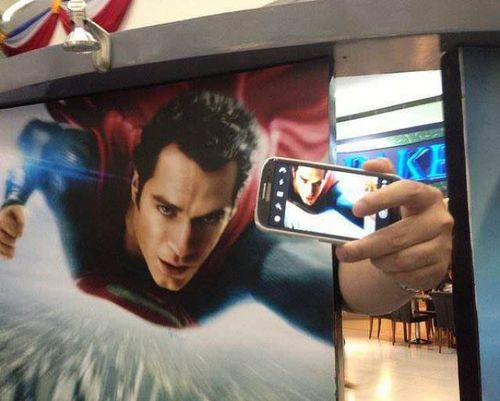 superman taking a selfie, movie poster hacked irl