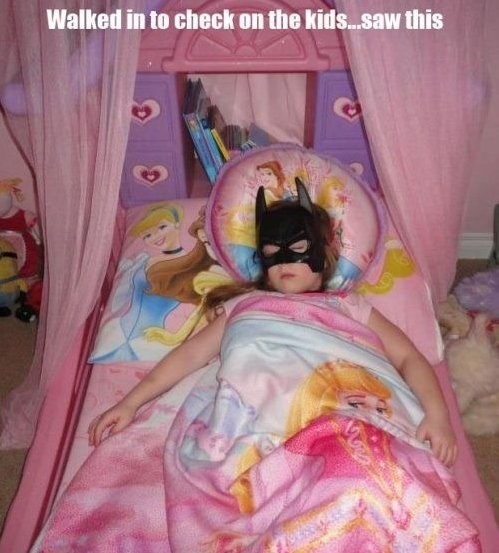 The Dark Princess, walked in to check on the kids and saw this, little girl wearing batman mask sleeping in princess bed
