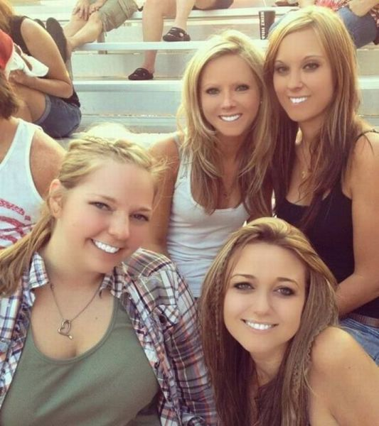 four girls with extremely white teeth