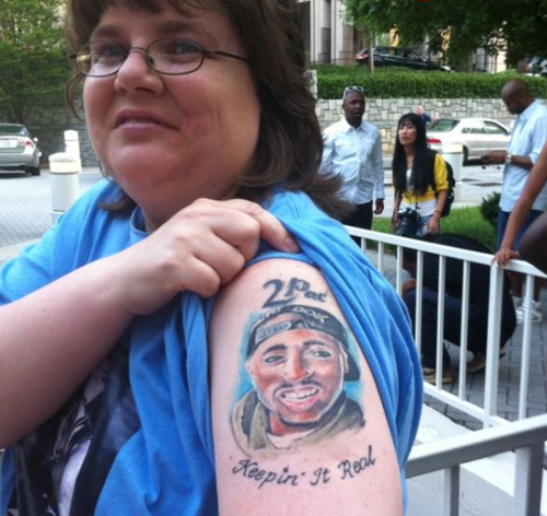 tupac tattoo on old white lady's arm, keeping it real