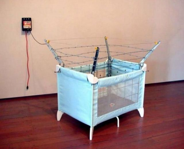 baby crib, electric barb wire fence, bad parenting, fail