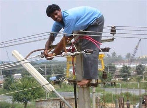 power lines, telephone wire, indian man, unsafe work conditions