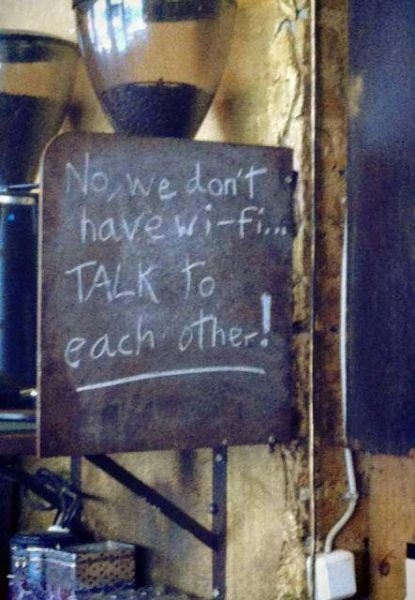 no wifi, talk to each other, sign, black board, cafe, lol
