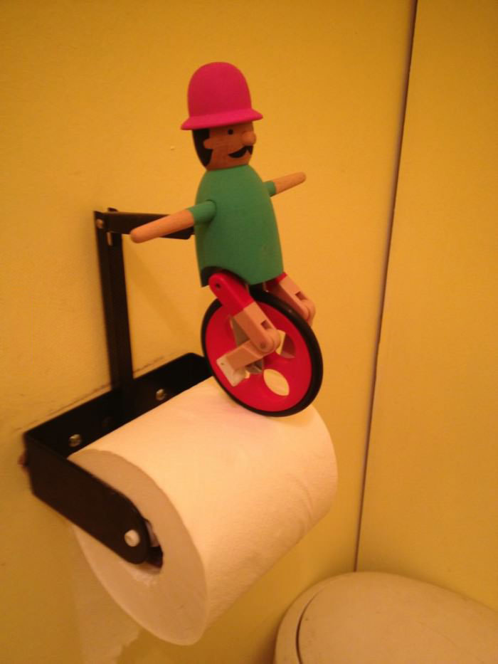 toilet paper figurine, unicycle, lol, product, wtf