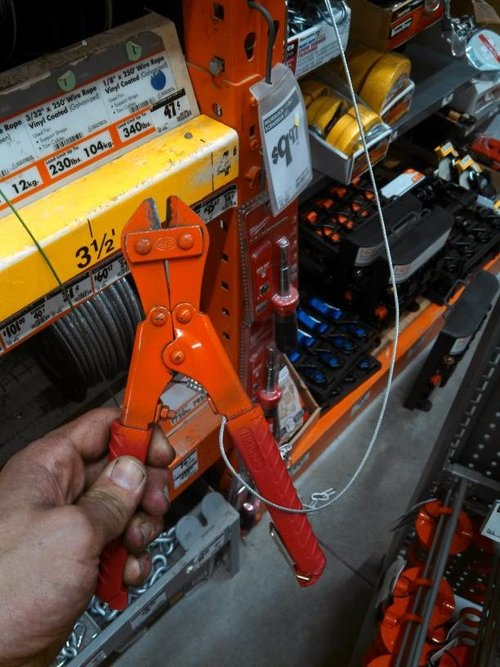 wire cutter restrained by a wire, tool, fail, stupid, genius
