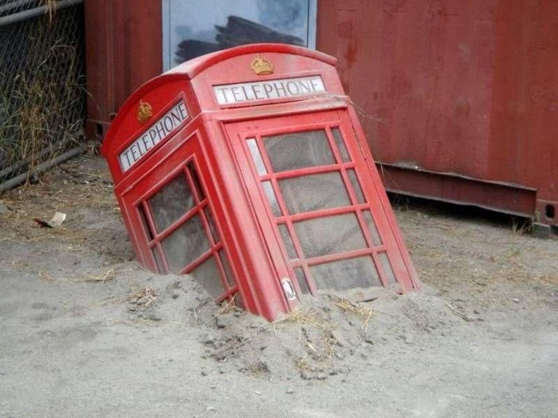 telephone booth, buried