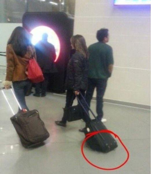 airport, bag, fail, rollers, upside down, dumb