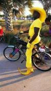 pimp, bicycle, yellow suit and hat