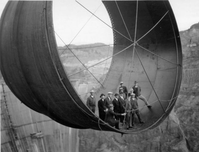 old photo, engineers, giant metal piece