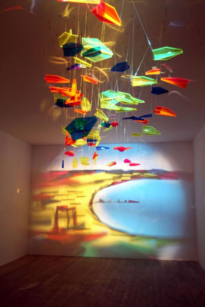 art, light, beach, shattered glass on string
