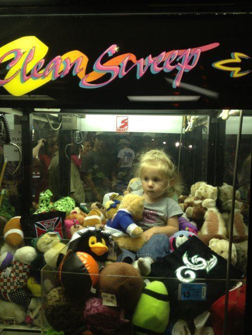 stuffed animal machine, little girl, lol, the claw