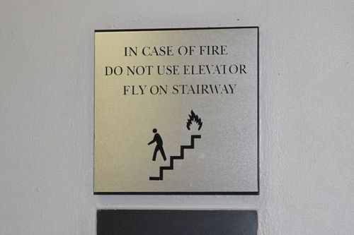 sign, fail, wtf, in case of fire do not use elevator or fly on stairway