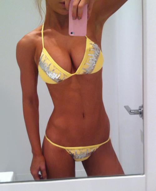 girl in yellow bikini takes selfie