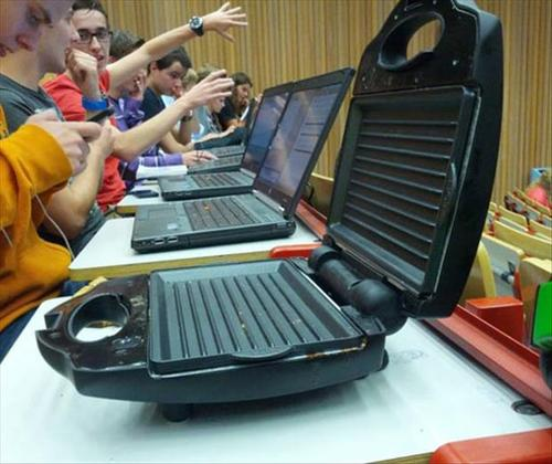 row of laptops with portable girl at the front, wtf