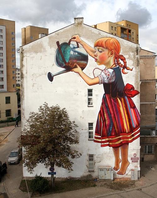 street art, side of building, win, little girl watering tree