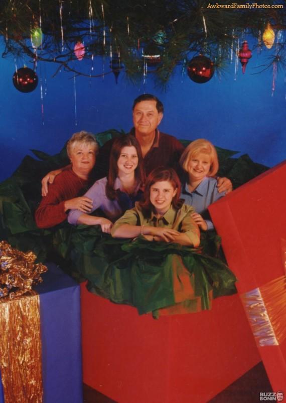awkward family photos, inside a present box under a tree, christmas