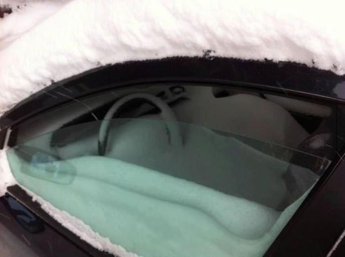 fail, car window left open during a snow storm