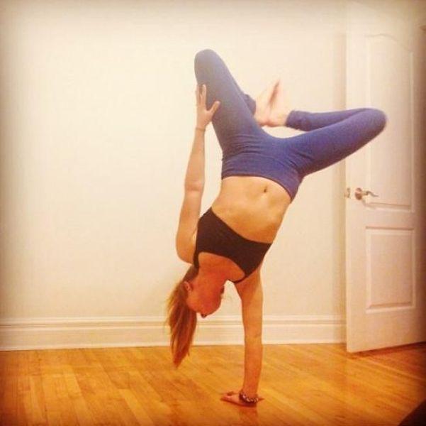 girl balancing on one hand