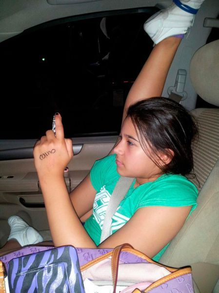 flexible girl in car, selfie