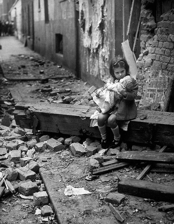 this little girl sits with her doll in the ruins of her london home that was bombed in 1940, war, historical photos