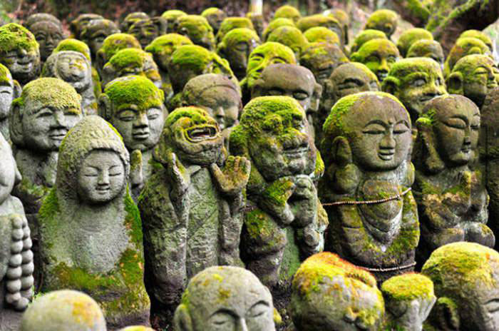there's always one in the crowd, ancient oriental statues