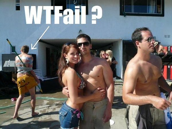 photobomb level wtf, guy duct taped to broom stick, couple shot