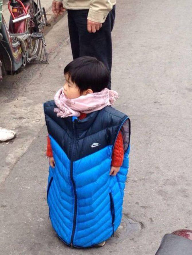 little boy wearing adult sized jacket