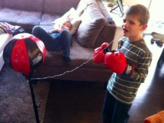 that's one way to get your kid of get his own tooth out, boxing gloves