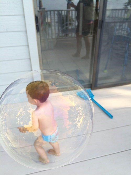 perfectly timed photo of the day: baby in a bubble