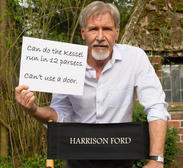 can do the kessel run in 12 parsecs, can't use a door, harrison ford holding a sign on the set of the new star wars movie